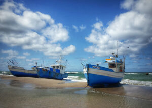 Boats on a beach when the tide is out